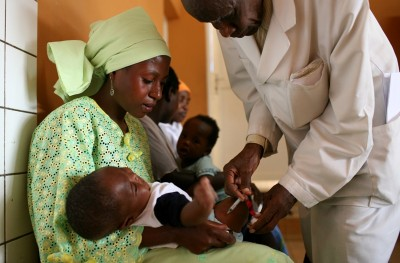 Abel Sekabarate head nurse helps mothers with their babies as they vaccinate small children for measles, polio and hepatitis on September 11, 2008 Kigali, Rwanda.(photo by Dominic Chavez)